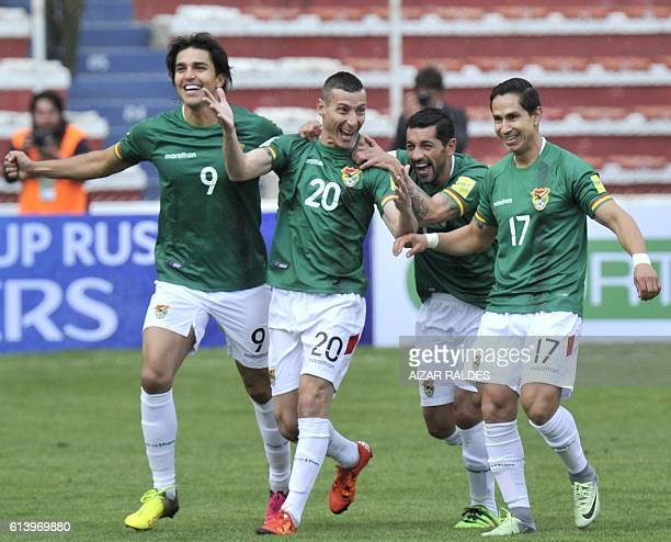 Bolivia's Pablo Escobar celebrates with Marcelo Martins Walter Flores and Marvin Bejarano after scoring against Ecuador during their Russia 2018 FIFA...