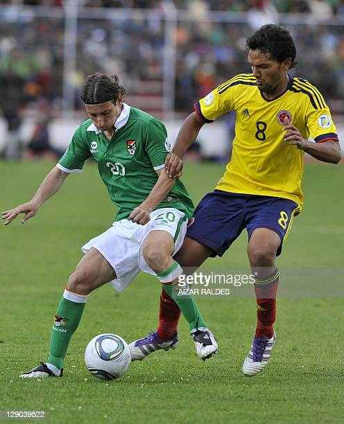 Bolivia's Pablo Escobar vies with Colombia's Abel Aguilar during their 2014 FIFA World Cup qualifier match against Bolivia at the Hernando Siles...