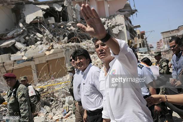 Bolivia's President Evo Morales and his Ecuadorean counterpart Rafael Correa visit the heavily damaged El Tarqui sector of Manta Ecuador on April 27...