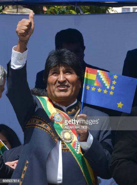Bolivia's President Evo Morales Ayma gives the thumb up as he observes from the presidential box the civilmilitary parade during the ceremony that...