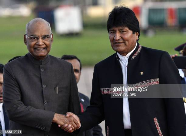 Bolivia's President Evo Morales Ayma shakes hands with India's President Ram Nath Kovind upon his arrival at Viru Viru airport in Santa Cruz Bolivia...