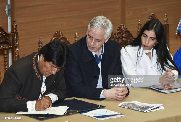 Bolivia's President Evo Morales Ayma VicePresident Alvaro Garcia Linera and Health Minister Gabriela Montano sign the enactment of a law that grants...