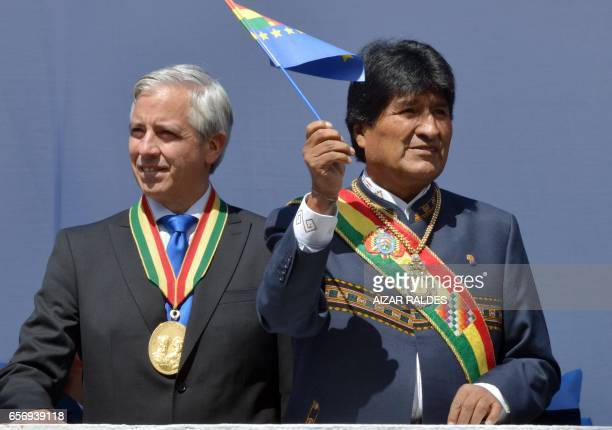 Bolivia's President Evo Morales Ayma waves a maritime claim flag next to Vicepresident Alvaro Garcia Linera during the ceremony that marks the 138th...
