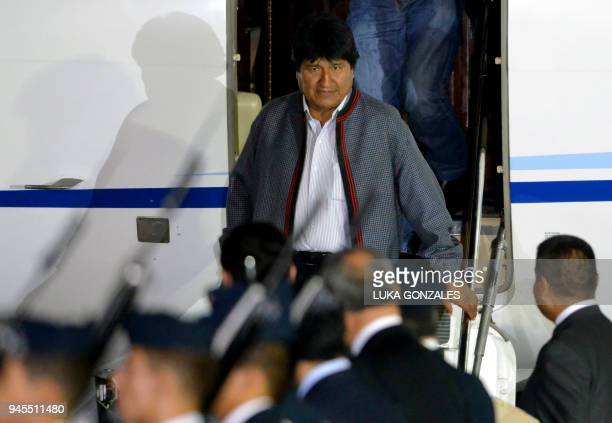 Bolivia's President Evo Morales disembarks upon arrival at the Peruvian Air Force Grupo Aereo Nº 8 base in Callao Lima on April 12 to take part in...