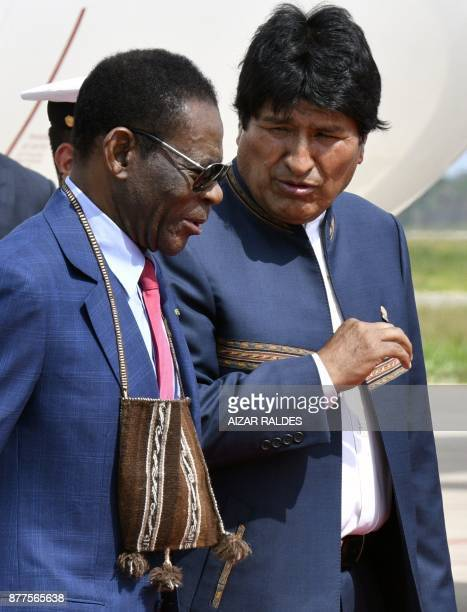 Bolivia's President Evo Morales greets his counterpart from Equatorial Guinea Teodoro Obiang Nguema upon the latter's arrival at Viru Viru airport in...