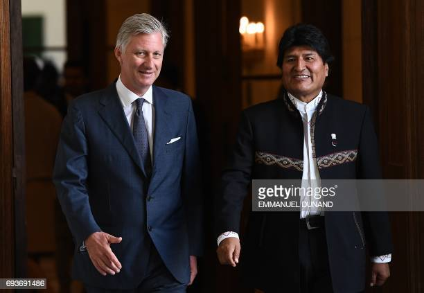 Bolivia's President Evo Morales is welcomed by Belgium King Philippe prior to a meeting at the Royal Palace in Brussels on June 8 2017 / AFP PHOTO /...