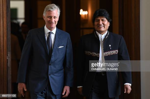 Bolivia's President Evo Morales is welcomed by Belgium King Philippe prior to a meeting at the Royal Palace in Brussels on June 8, 2017. / AFP PHOTO...