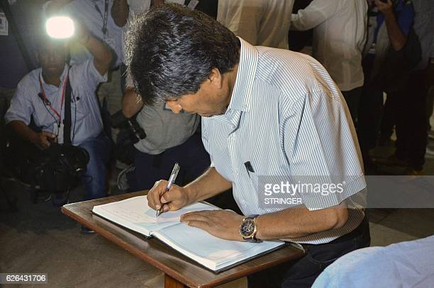 Bolivia's President Evo Morales signs the condolences book after paying his last respects to Cuban revolutionary icon Fidel Castro in Havana on...