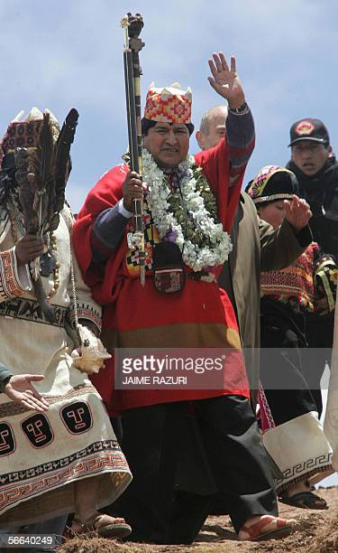 Bolivia's Presidentelect Evo Morales waves after a ritual perfomed by four Amautas during an elaborate ceremony where he was crowned as supreme chief...