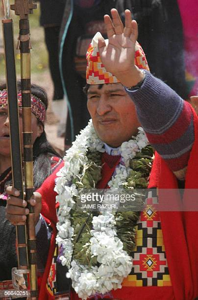 Bolivia's Presidentelect Evo Morales waves after a ritual performed by four Amautas during an elaborate ceremony where he was crowned as supreme...