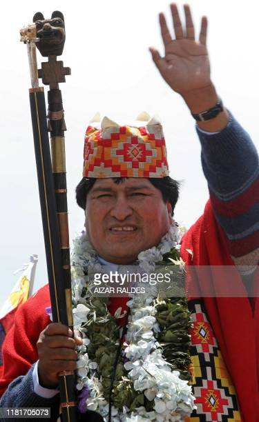 Bolivia's President-elect Evo Morales waves at supporters after an elaborate ceremony where he was crowned as supreme chief of Andean Indians, 21...