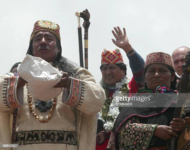 Bolivia's Presidentelect Evo Morales waves to supporters during a purification ritual performed by Amautas in the Akapana site of the sacred place of...
