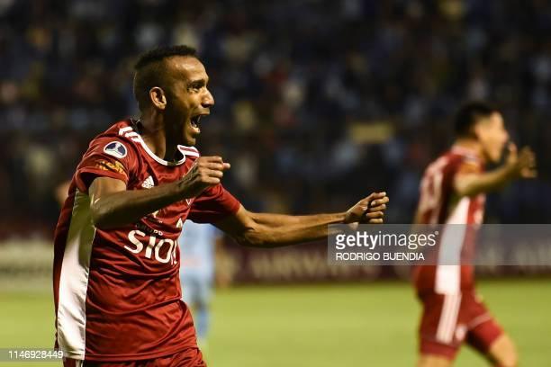 Bolivia's Royal Pari player Thiago Vasconcelos celebrates after scoring a goal against Macara from Bolivia during their Copa Sudamericana football...