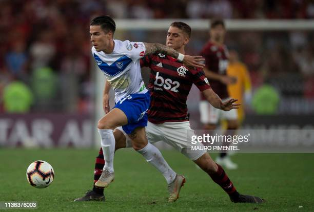 Bolivia's San Jose Javier Andres Sanguinetti drives the ball past Brazil's Flamengo Gustavo Cuellar during their Copa Libertadores football match at...