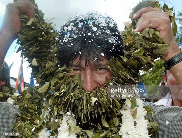 Bolivia's socialist president-elect, Evo Morales, takes off a garland of coca leaves during a gathering with supporters in Eterazama, El Chapare,...