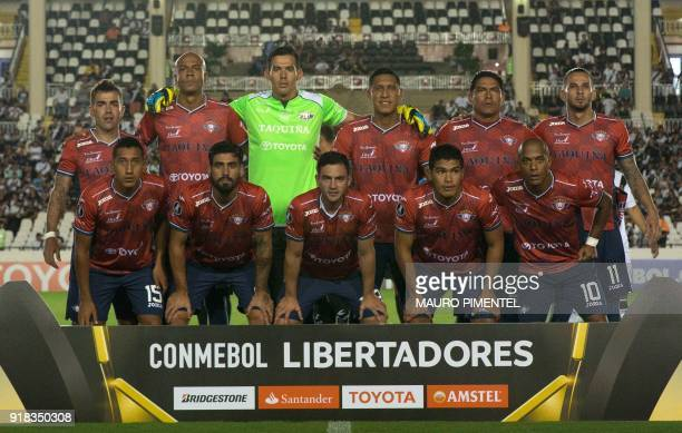 Bolivia's team Jorge Wilstermann poses for pictures before the start of the Libertadores Cup football match against Brazil's Vasco da Gama at the Sao...