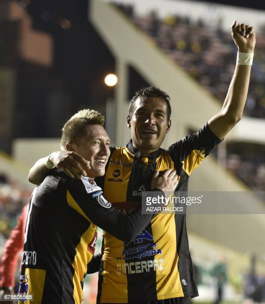 Bolivia's The Strongest players Walter Veizaga and Alejandro Chumacero celebrate after scoring against Peru's Sporting Cristal during their Copa...