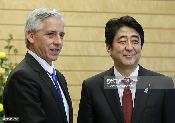 Bolivia's Vice President Alvaro Garcia Linera poses with Japan's Prime Minister Shinzo Abe at the start of talks at the latter's official residence...