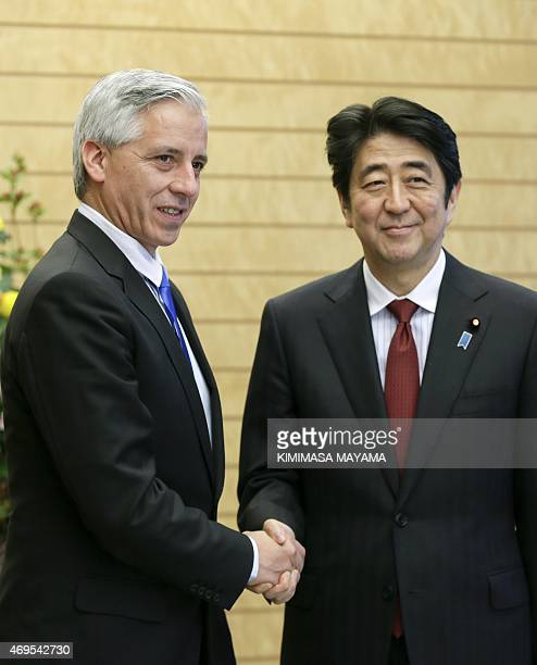 Bolivia's Vice President Alvaro Garcia Linera shakes hands with Japan's Prime Minister Shinzo Abe at the start of talks at the latter's official...