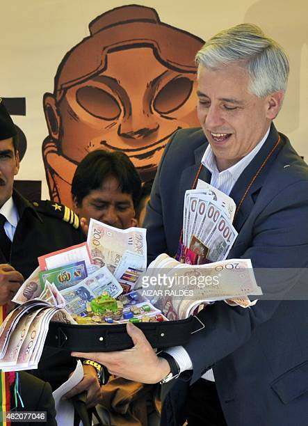 Bolivia's Vice President Alvaro Garcia Linera shows a present given by La Paz's mayor Omar Rocha during the inauguration of the Alasitas a festivity...