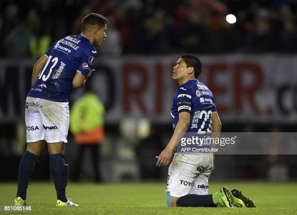 Bolivia's Wilstermann defender Edward Zenteno and midfielder Daniel Mancilla argue after Argentina's River Plate forward Ignacio Scocco scores during...
