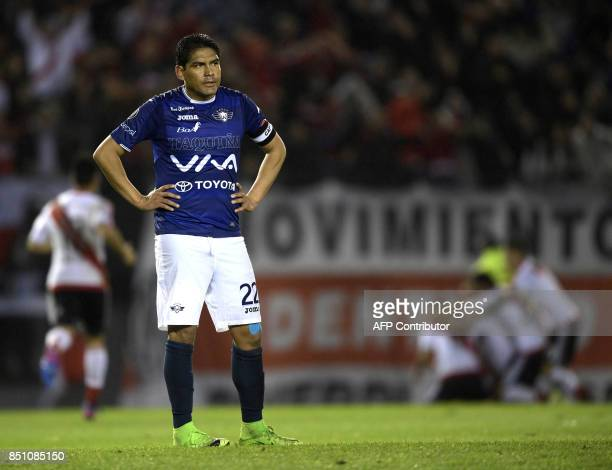 Bolivia's Wilstermann defender Edward Zenteno reacts after Argentina's River Plate midfielder Enzo Perez scores during the Copa Libertadores 2017...
