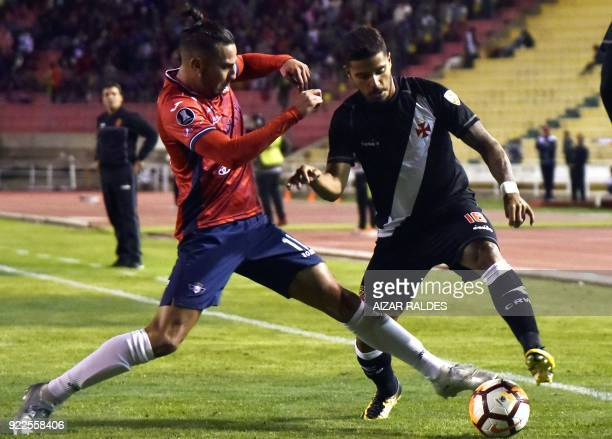 Bolivia's Wilstermann player Alejandro Melean vies for the ball with Henrique of Brazil's Vasco Da Gama during their Copa Libertadores football match...
