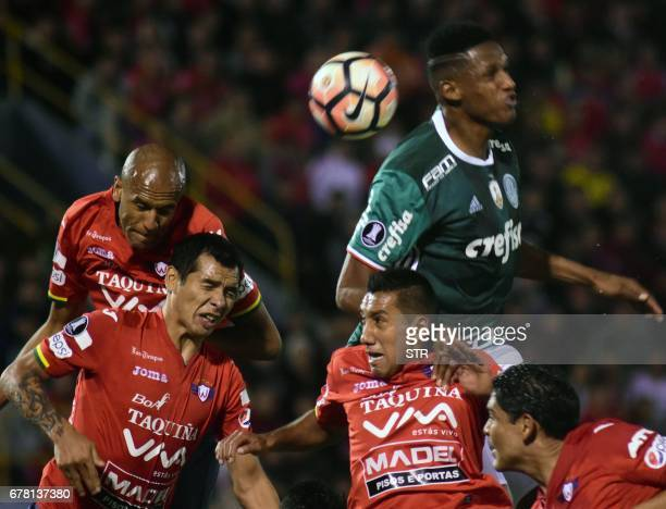 Bolivia's Wilstermann players Alex Silva Omar Morales and Juan Pablo Aponte vie for the ball with Yerry Mina of Brazil's Palmeiras during their Copa...