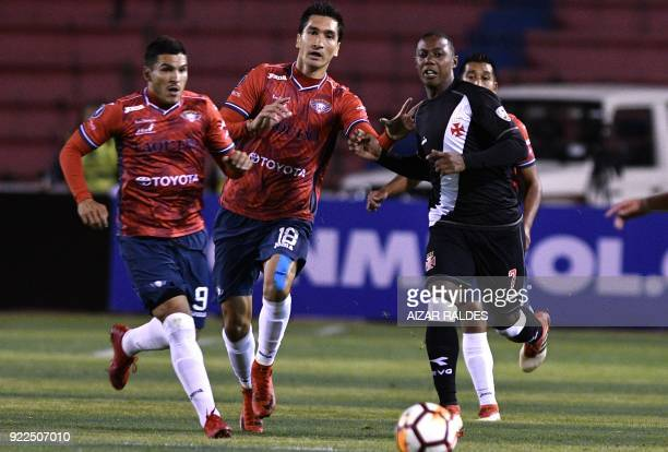 Bolivia's Wilstermann players Ricardo Pedriel and Cristian Chavez vie for the ball with Brazil's Vasco Da Gama player Wellington during their Copa...