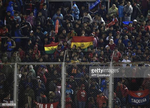 Bolivia's Wilstermann supporters cheer for their team during the Copa Libertadores 2017 quarterfinals second leg football match against Argentina's...