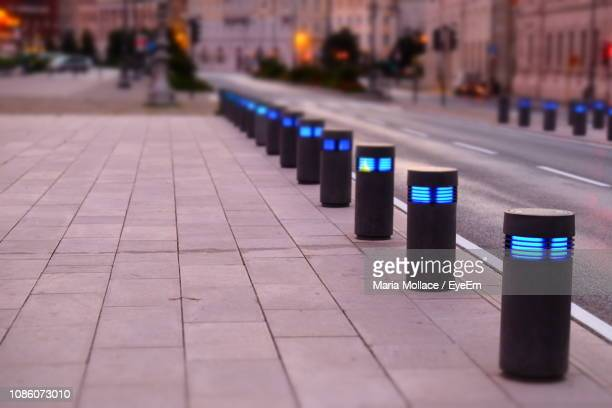 bollard at pathway in city - bollard stock photos and pictures