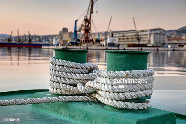 bollards and white rope - bollard stock photos and pictures