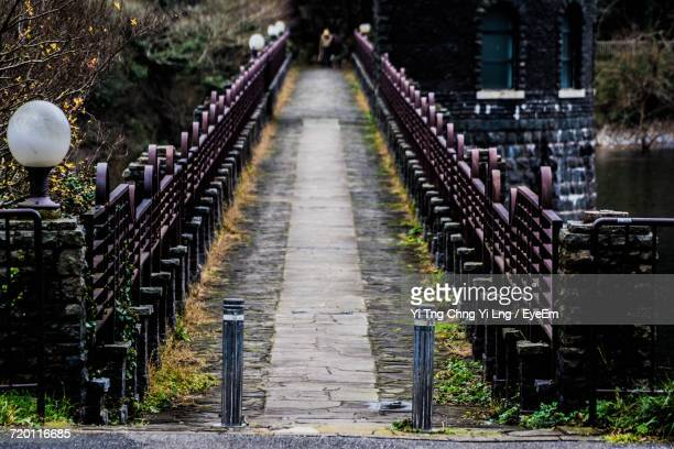 bollards at bridge over lake in city - bollard stock photos and pictures