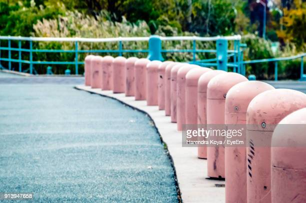 bollards by road - bollard stock photos and pictures