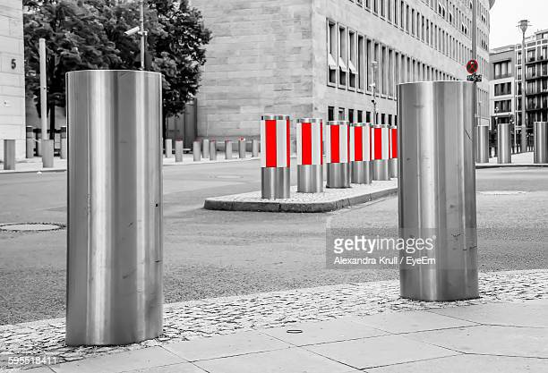 bollards in city - bollard stock photos and pictures