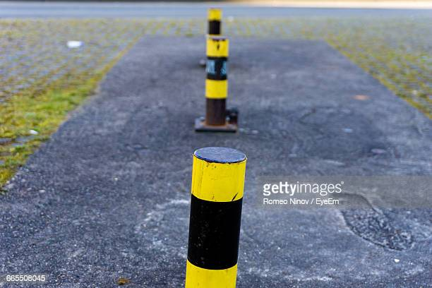 bollards in row on street - bollard stock photos and pictures