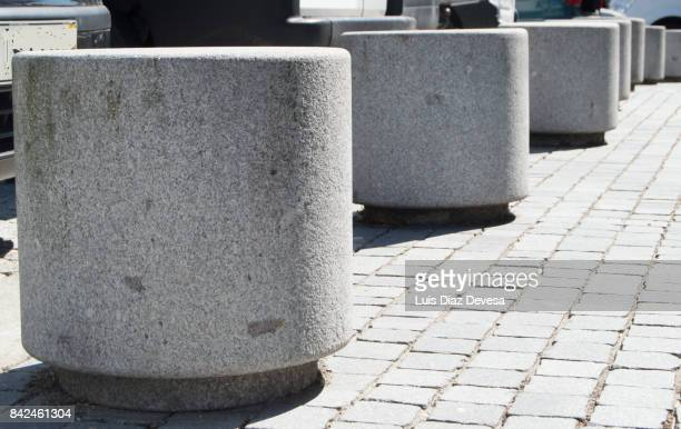 bollards made of cements - bollard stock photos and pictures