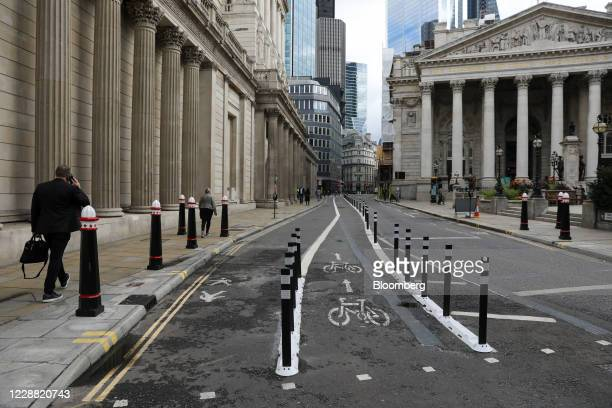 Bollards protect a cycle lane and an extended pedestrian area outside the Bank of England in the Square Mile financial district of the City of...