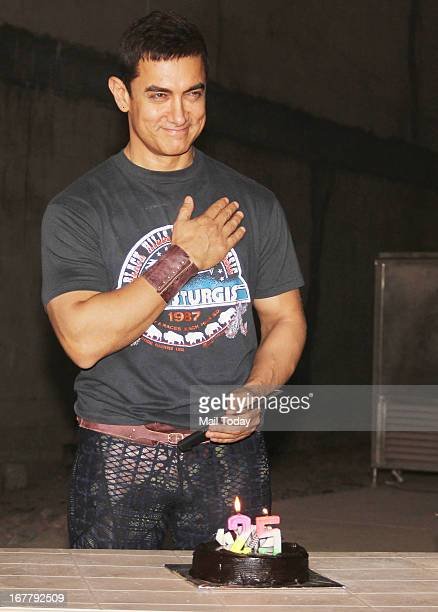 Bollywood actor Aamir Khan cuts cake as he celebrates 25 years in Bollywood in Mumbai