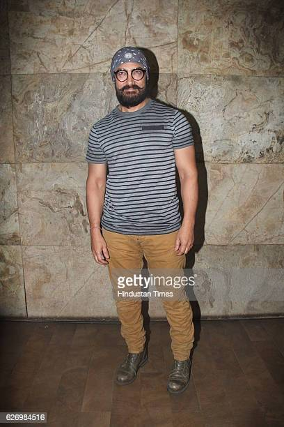 Bollywood actor Aamir Khan during screening of making of Dangal at Lightbox Santacruz on November 28 2016 in Mumbai India Dangal is a sports biopic...