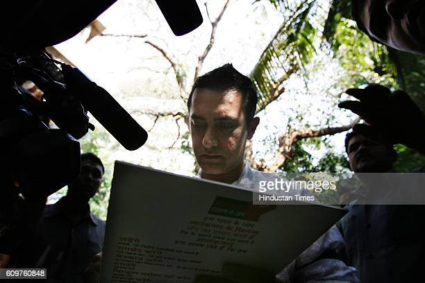 Bollywood actor Aamir Khan gestures during a press conference on the occasion of Eid alAdha at his residence Muslims around the world celebrate Eid...