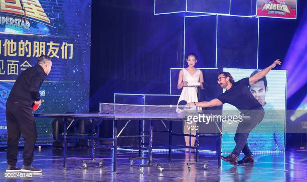 Bollywood actor Aamir Khan plays table tennis with former Chinese table tennis player Liu Guoliang during 'Secret Superstar' press conference on...