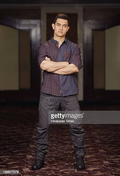 Bollywood actor Aamir Khan poses for a picture at Taj Lands End, Bandra on November 15, 2012 in Mumbai, India.
