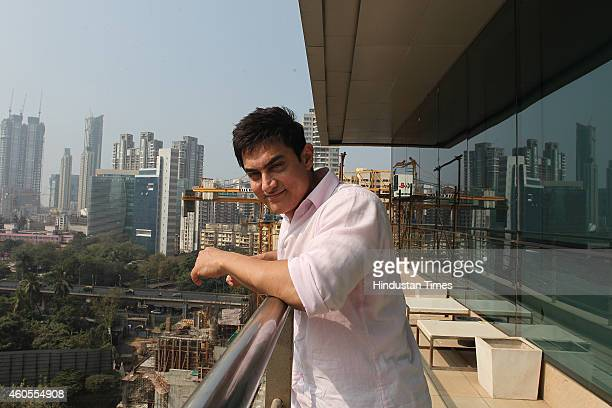 Bollywood actor Aamir Khan poses for a picture during a visit to HT office for the promotion of his upcoming film PK on December 12 2014 in Mumbai...
