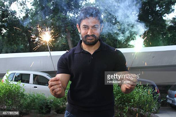 Bollywood actor Aamir Khan posing for a exclusively Diwali special shoot for HTCityHindustan Times at Hotel LeMeridian on October 19 2014 in New...