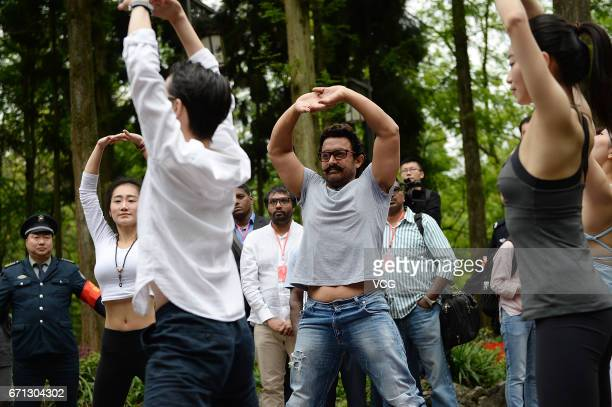Bollywood actor Aamir Khan practices yoga at Mount Qingcheng on April 20 2017 in Chengdu China