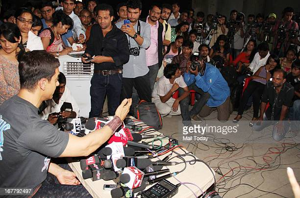 Bollywood actor Aamir Khan talks to media as he celebrates 25 years in Bollywood in Mumbai