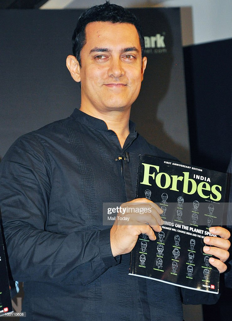 Bollywood actor Aamir Khan unveils a first anniversary edition of Forbes Magazine in Mumbai on May 20, 2010.