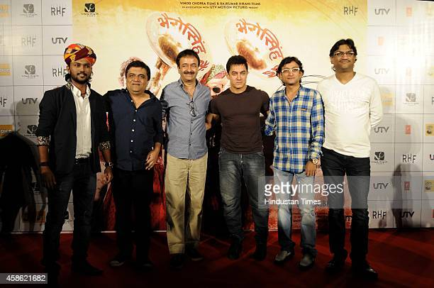 Bollywood actor Aamir Khan with director Rajkumar Hirani and singer Swaroop Khan during the launch of song from the upcoming Bollywood movie PK on...