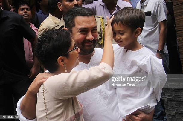 Bollywood actor Aamir Khan with wife Kiran Rao and son Azaad greets fans at Carter Road residence on the occasion of EID on July 18 2015 in Mumbai...
